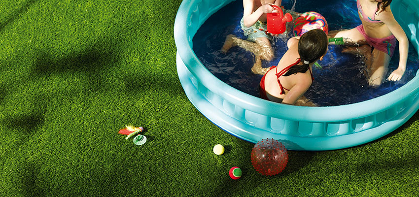 kids play on artificial grass