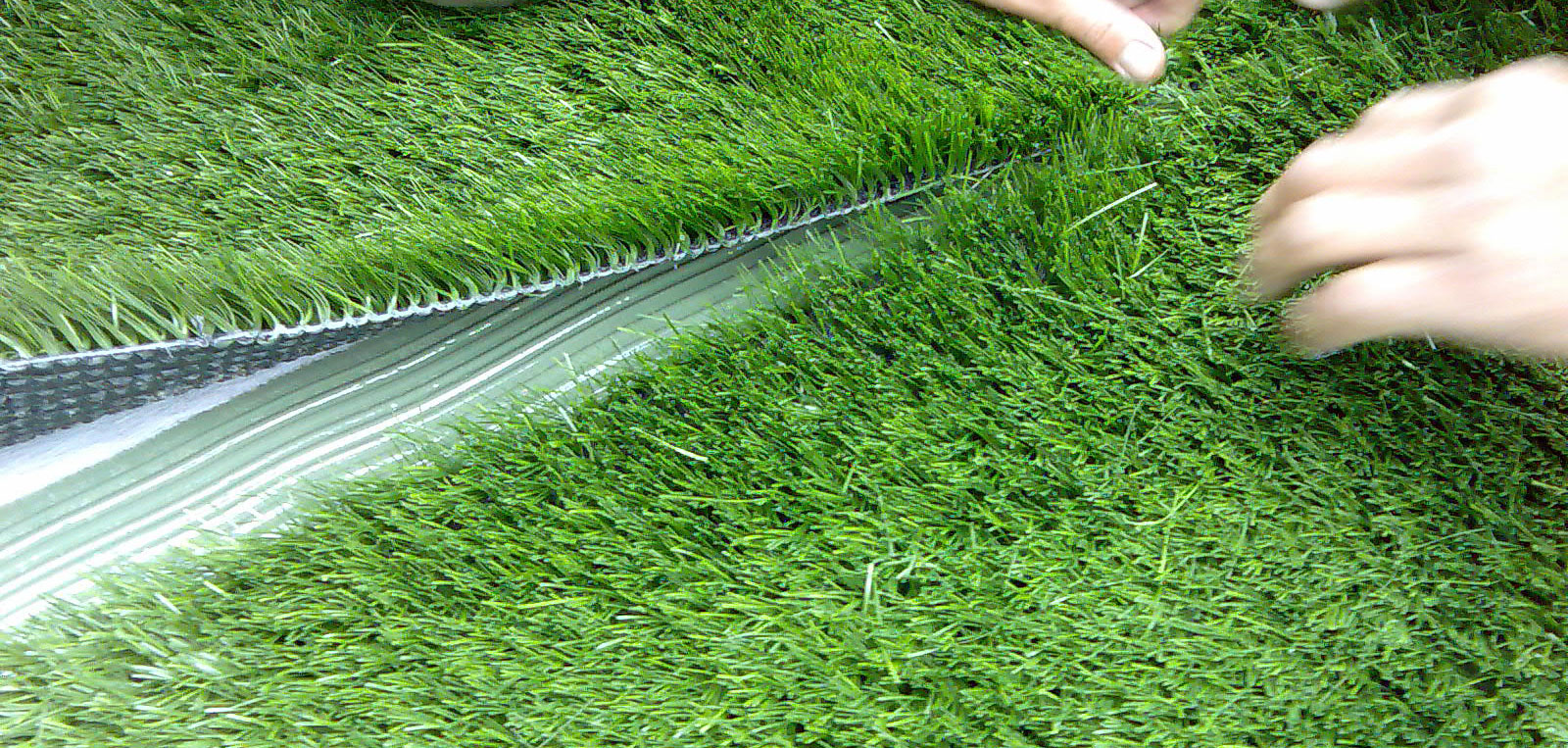 how to lay artificial grass on real grass